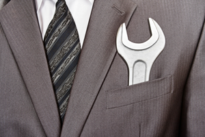 photo of business man with a wrench in his pocket